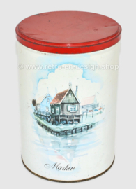 Vintage tin storage container with a watercolour of wooden houses on Marken