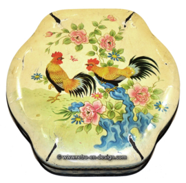 Vintage biscuit tin with roosters and flowers