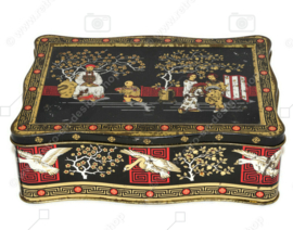 Vintage tea tin in black, gold and red with oriental images