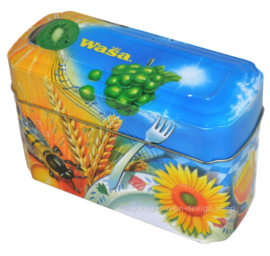 Orange and blue tin box for Wasa Crackers with images of a rooster, bee, sunflower, grain and fruit
