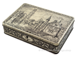 Vintage tin by G.B.C. Belgium with the city of Bruges embossed on lid