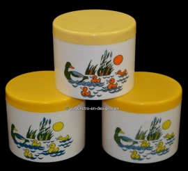 Plastic jars or storage containers with duck and ducklings