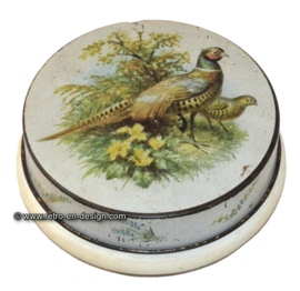 Round vintage tin with image of pheasants