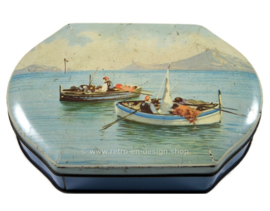 Scalloped vintage tin with fishing boats