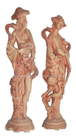 Sculptures of Oriental wise man and woman in cast resin