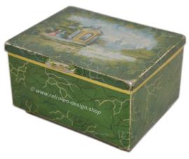 Vintage groen theeblik van Douwe Egberts met voorstelling van twee dames bij theehuis