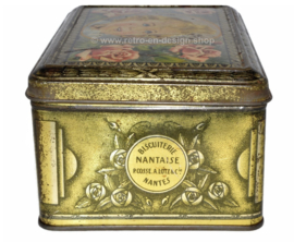 Vintage tin La Biscuiterie Nantaise with a young girl and roses on the lid