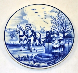 Delftware plate the four seasons 'Spring' (cleaning)