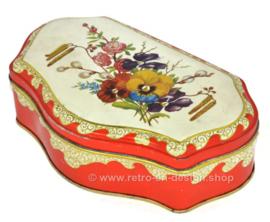 Lata de té vintage roja festoneada de DE GRUYTER con decoración floral
