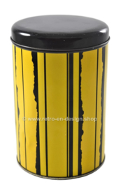 Vintage round tin by Tomado. Yellow with black stripes