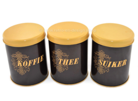 Set of three vintage tin canisters for coffee, sugar and tea