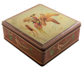 Vintage tin by Van Melle with depiction of bird of prey and pheasant