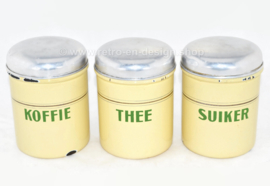 Set of three cream-coloured brocante enamelled storage containers for Coffee, Sugar and Tea with reseda green letters
