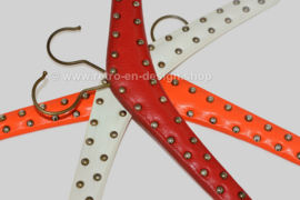 Set of three vintage vinyl coat hangers in red, white and orange with metal studs