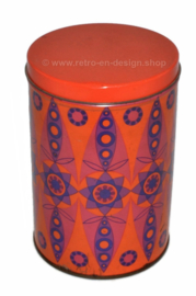 Vintage orange Tomado tin with kaleidoscopic pattern