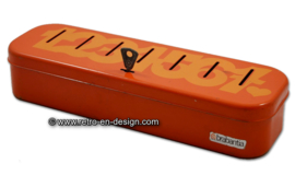 Brabantia orange household money box, numbered 1 to 7. Incl. key