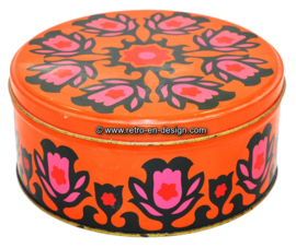 Round orange vintage biscuit tin with tulip pattern