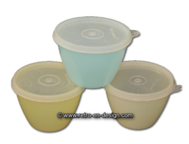 Set of three Tupperware bowls with lids