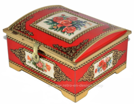 Red vintage tin candy box with rose decoration