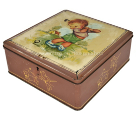 Vintage candy tin, storage tin or tin drum made by Van Melle with a drawing of a golfing boy