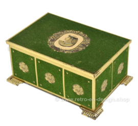 Vintage gold-coloured box covered with green felt, depicting Cleopatra