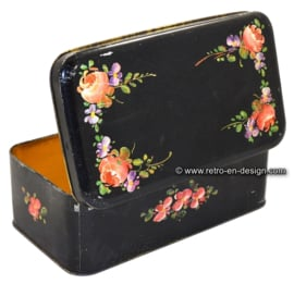 Vintage black craquelure tin with floral pattern