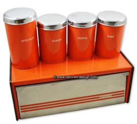 Vintage oranje Brabantia broodtrommel en voorraadbussen