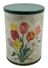 Grote vintage ronde blikken trommel met voorjaarsbloemen als tulp en narcis
