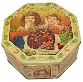 Vintage old octagonal tin. Mommy's Rich Fruity Cake