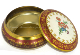 Round vintage tin with flowers on lid