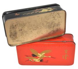 Ensemble de deux boîtes vintage en noir et rouge par DE GRUYTER à décor d'oiseaux orientaux