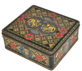 Vintage square tea tin with oriental motifs, dragons, wajang and flowers