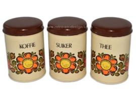 Set van drie blikken voorraadbussen voor koffie, suiker en thee