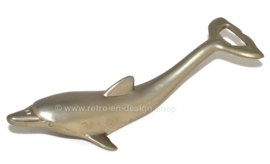 Vintage bottle opener in the shape of a dolphin