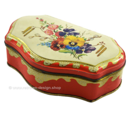 Red vintage tea tin by the Gruyter with spring or summer bouquet