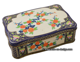 Vintage blue biscuit tin with flower pattern