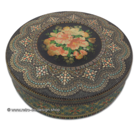 Round vintage biscuit tin with embossed beaded decoration and floral motifs