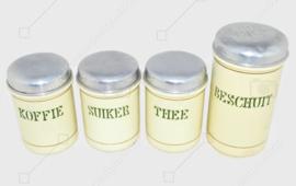 Set aus vier cremefarbenen brocante emaillierten Vorratsdosen für Kaffee, Zucker, Tee und Zwieback mit resedagrüner Schrift