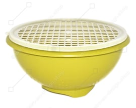 Green coloured vintage Tupperware colander with a white transparent grid