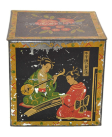 Vintage tea tin in cube shape with oriental images