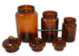Set of three brown glass storage jars