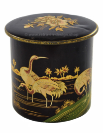 Round vintage tin canister decorated with cranes