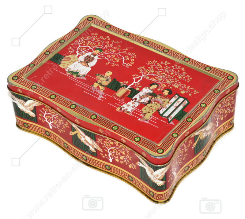 Vintage tea tin in red, green, gold and black with oriental images