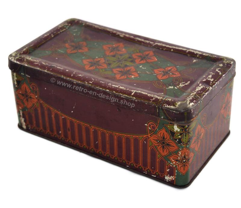 Alte brocante Blechdose mit stilisierten Blumenmuster