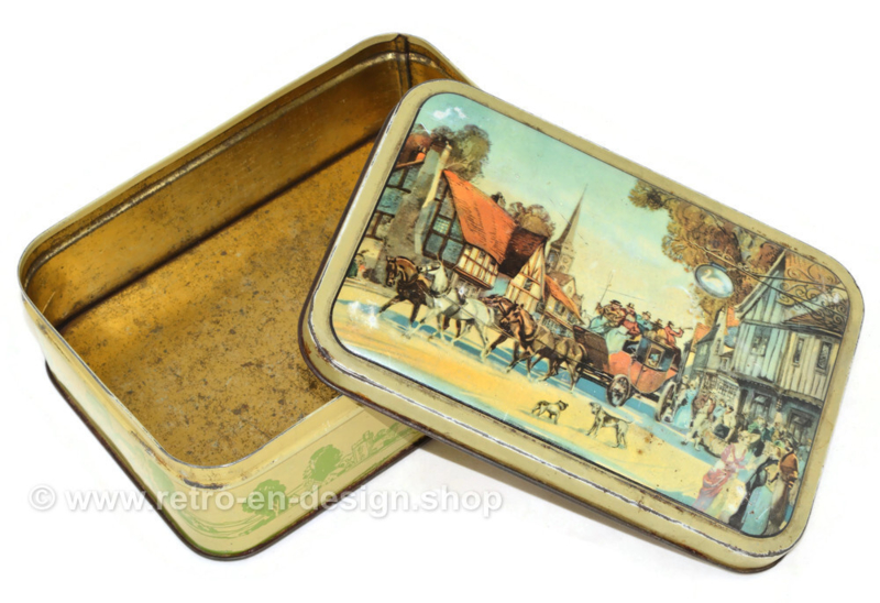 Vintage tin box depicting a carriage in a village