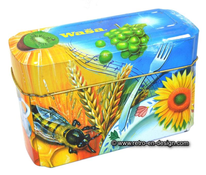 Vintage bewaarblik voor Crackers van Wasa met bij, zwaluw, haan