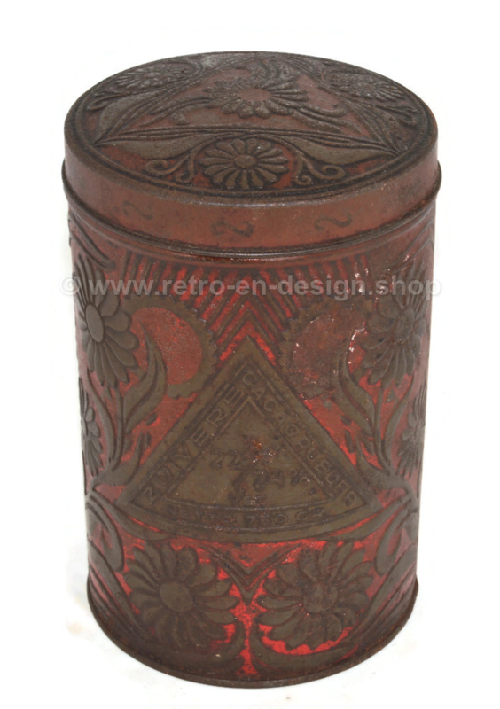 Red tin canister with embossed floral motif for cocoa powder by EJO
