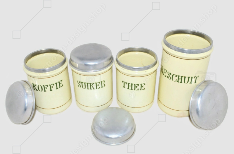 Set of four cream-coloured brocante enamelled storage containers for coffee, sugar, tea and rusk with reseda green letters