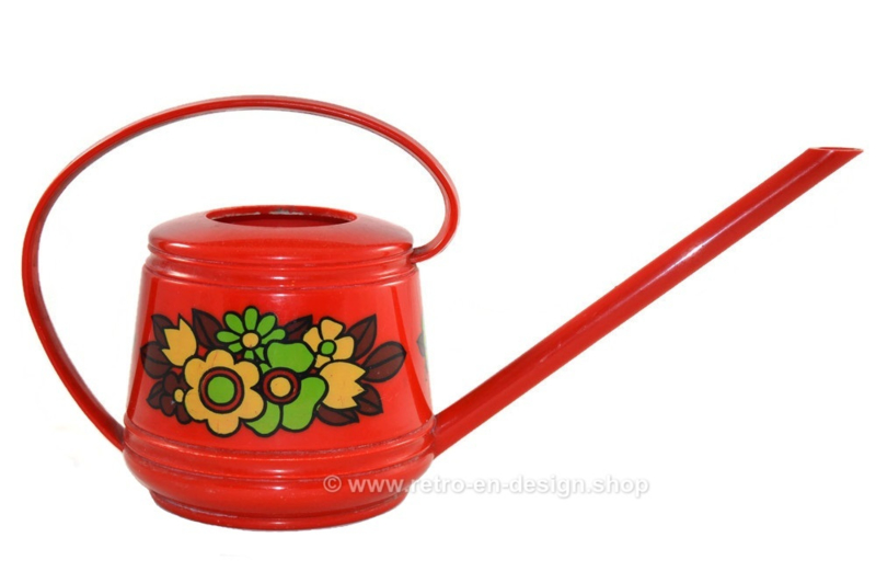 Red vintage plastic Emsa watering can with floral decoration