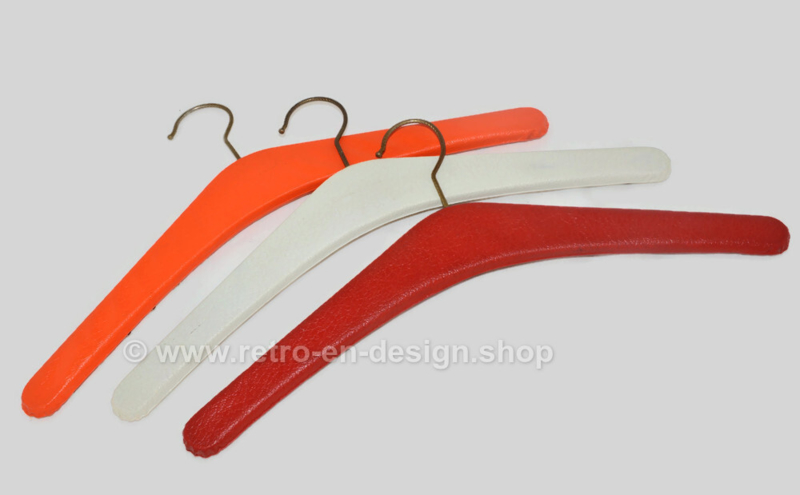 Set of three vintage vinyl coat hangers in red, white and orange with metal studs